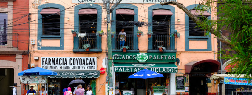 Colonial buildings and restaurants in Coyoacan, a historic neighborhood in Mexico City.