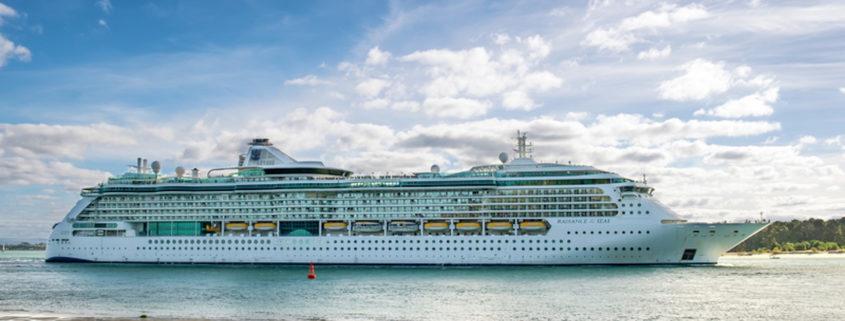 Family waving to cruise ship