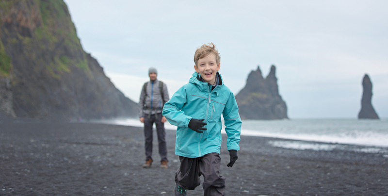Father and son on summer vacation in Iceland.