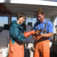 Measuring lobsters on a Lucky Catch Boat Tour.