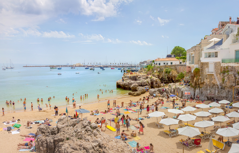 Cascais beach, filled with resting people in a summer sunny day