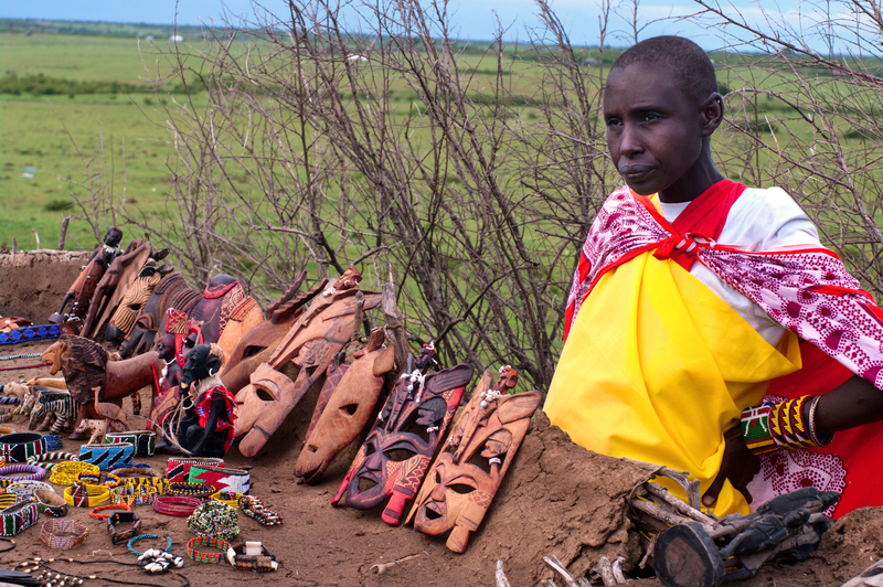 Local woman sells traditional souvenirs in Maasai Mara, Kenya. The Maasai are the most famous tribe in Africa. Photo: Byelikova | Dreamstime.com