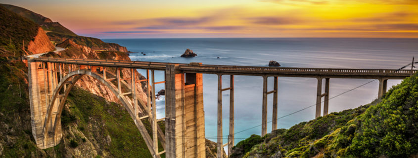 Bixby Bridge (Rocky Creek Bridge) and Pacific Coast Highway at sunset near Big Sur in California