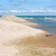 Indiana Dunes National Lakeshore is a National Park on Lake Michigan's south shore. The sand dunes make this beach a popular tourist attraction in Indiana.